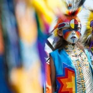 Two Indigenous children dressed in Aboriginal regalia