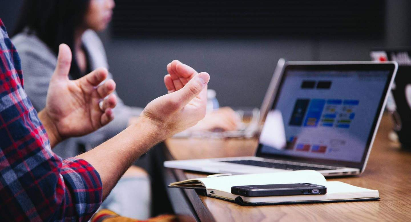 hands in front of an entrepreneur's computer