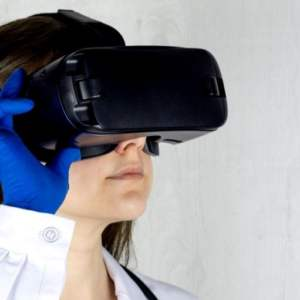 A doctor wears a VR headset to illustrate telemedicine and the future of healthcare