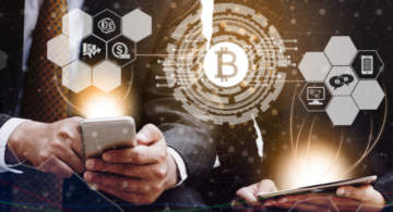 A person working with his smartphone. A Bitcoin logo in the middle.