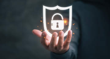 A hand holding a lock symbol - Cybersecurity
